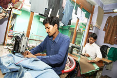 Two indian man tailors Royalty Free Stock Image