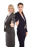 Portrait: Two isolated successful happy business woman making th Royalty Free Stock Images
