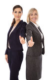 Portrait: Two isolated successful happy business woman making th Stock Photos