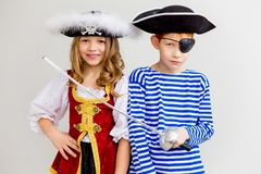 Kids in a pirate costume. A portrait of two kids in a pirate costume royalty free stock photo