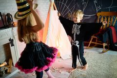 Carefree Kids at Halloween Party royalty free stock photography