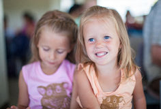 Portrait of two little beautiful blue eyed girls. Portrait of two little beautiful blue-eyed girls Royalty Free Stock Photo