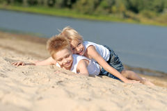 Portrait of two little boys on the beach Stock Image