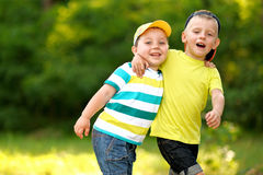 Portrait of two little boys friends. In summer Stock Photography