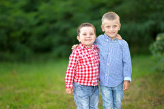 Portrait of two little boys friends. In summer Royalty Free Stock Photo