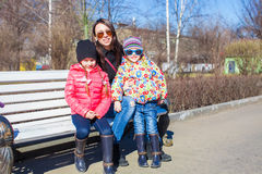 Portrait of two little cute girls and young mother have fun in the city Stock Photography