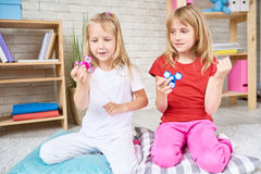 Little Girls Playing with Fidget Spinner stock photos