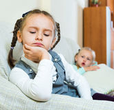 Portrait of two little miserable girls having conflict Royalty Free Stock Image
