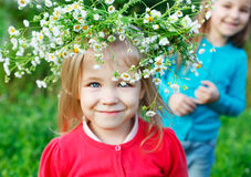 Portrait of two little sisters outdoors wearing wreath from whit Royalty Free Stock Images