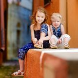 Portrait of two little sisters at summer Stock Photo