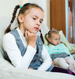 Portrait of two little upset miserable girls having conflict. At home stock photo