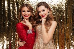 Portrait of two lovely pretty women in sparkly dresses Stock Photography