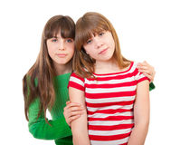 Portrait of two lovely sisters Stock Photos