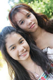 Portrait of two lovely Thai girls Royalty Free Stock Image
