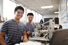 Portrait Of Two Male College Students Building Machine In Science Robotics Or Engineering Class stock image