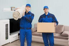 Two Male Movers Standing In House Royalty Free Stock Images