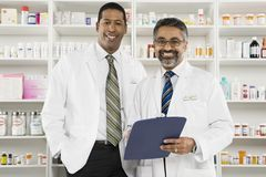 Portrait Of Two Male Pharmacists Stock Photography