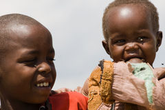 Portrait of two Masai children in Masai Mara Royalty Free Stock Photos