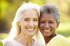 Portrait Of Two Mature Female Friends Hugging stock photos