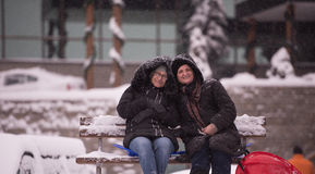 Portrait of two mature woman sitting in park at  winter day Stock Photo