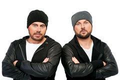 Portrait of two men in black jackets and hats Stock Photography