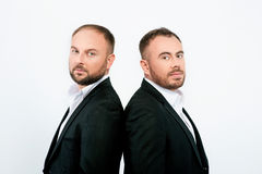 Portrait of two men in black suits Royalty Free Stock Photos