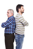 Portrait of two men, father and son, standing back to back with Stock Photo