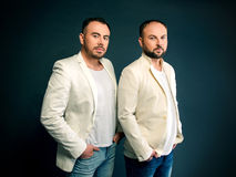 Portrait of two men in white suits Stock Photos
