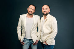 Portrait of two men in white suits Royalty Free Stock Images