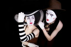 Portrait of two mimes in white gloves Royalty Free Stock Image