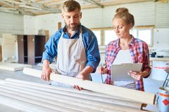 Carpenters Choosing Wood in Joinery stock photos