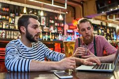 People Using Laptop in Bar royalty free stock photo