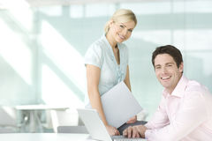 A portrait of two office colleagues, smiling stock image