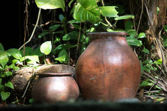Portrait of two old fashioned pots. stock photos