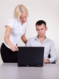 Portrait of two people working in office. Portrait of supervisor and his secretary Royalty Free Stock Photo