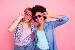 Portrait of two person nice cool crazy attractive charming cheerful cheery funny funky childish girls wearing casual royalty free stock images