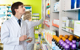 Portrait of two  pharmacists working in modern farmacy Royalty Free Stock Photo