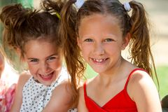 Portrait of two ponytailed girls. Royalty Free Stock Images