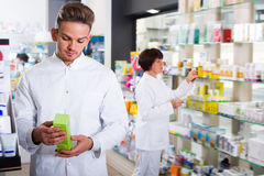 Portrait of two positive adult pharmacists Stock Images