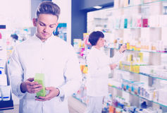 Portrait of two positive adult pharmacists Royalty Free Stock Photography