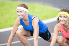Portrait of Two Pretty Caucasian Sportswomen Having Fun Time. At Sport Venue Outdoors.Horizontal Image Royalty Free Stock Photo