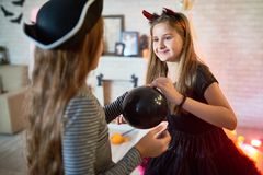 Girls Decorating Room for Halloween Party royalty free stock photos