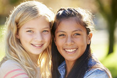 Portrait Of Two Pretty Girls In Countryside Stock Images