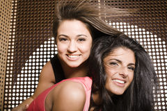 Portrait of two pretty girls enjoying party Royalty Free Stock Image