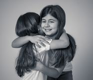 Two beautiful sisters hugging each other in happy moments together stock photography