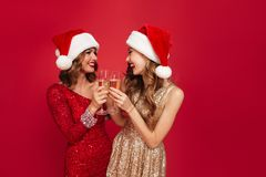 Portrait of two pretty smiling girls in shiny dresses Royalty Free Stock Photo