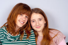 Portrait of two pretty teenage girls. Smiling Stock Photography