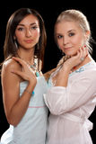 Portrait of a two pretty young women Stock Photos