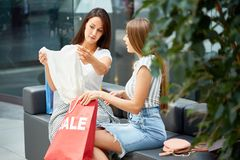 Two Young Women Shopping on Sale Stock Images
