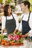 Portrait Of Two Sales Assistants In Florists Shop Stock Image